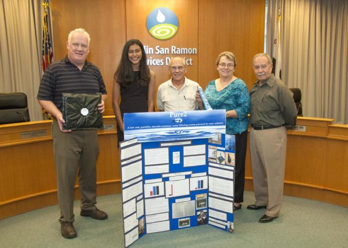 Contra Costa County Science & Engineering Fair Junior Division Excellence in Water Research Award Third Place Winner Arshia Mehta (black dress)  accepts her certificate and award check at the June 7th DSRSD Board Meeting. (L/R) DSRSD Directors: Vice President Richard Halket, President Pat Howard, Georgean Vonheeder-Leopold and Ed Duarte