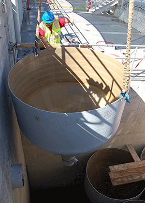 sand filter housing is lowered into underground area