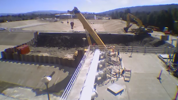 Time-lapse video of construction equipment and workers
