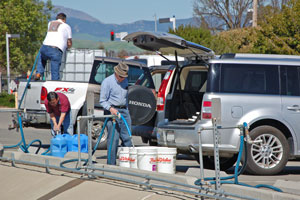 Users fill containers with recycled water at the Residential Recycled Water Fill Station.