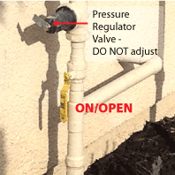 Ball Valve to turn water on/off in open position; warning to not touch pressure regulator.