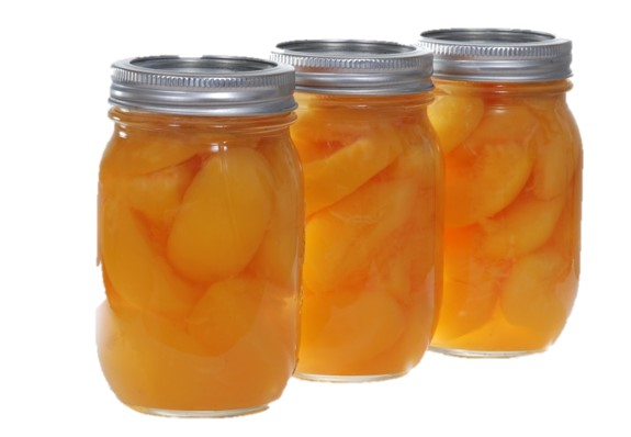 three jars of canned peaches