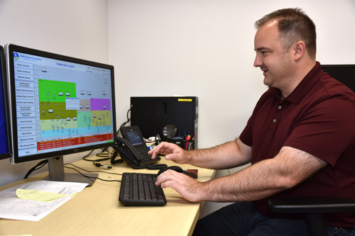 Water/Wastewater Systems Operations & Maintenance Supervisor Dan Martin uses a computer to look at the SCADA system.
