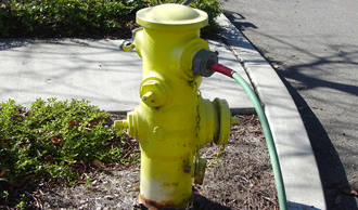 Garden hose connected illiegally to fire hydrant
